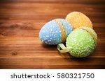 easter eggs on wooden background   Shutterstock . vector #580321750