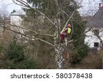 tree surgeon hanging from ropes ... | Shutterstock . vector #580378438