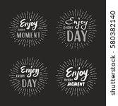 slogan enjoy every moment.... | Shutterstock .eps vector #580382140