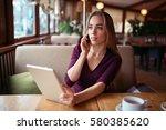 businesswoman work in cafe | Shutterstock . vector #580385620