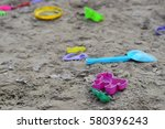 Abandoned Toys In A Sandbox