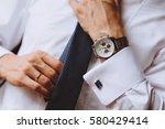 the man wears a blue tie a... | Shutterstock . vector #580429414