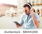 handsome young man standing  in ... | Shutterstock . vector #580441000
