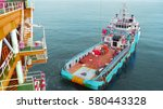 supply boat transfer cargo to... | Shutterstock . vector #580443328