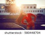 happy successful sportswoman... | Shutterstock . vector #580448704