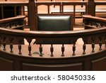 Small photo of A witness stand with a black seat in the court room infront of tribunal when witness testify of evidence to judge, they will sit at here for testimony of witnesses, it is vintage or retro style