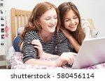 Two Teenage Girls In Bedroom...
