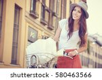 young woman walking with her... | Shutterstock . vector #580463566