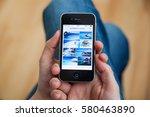kyiv   february11  hand holding ... | Shutterstock . vector #580463890