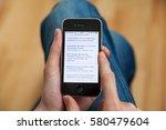 kyiv   february11  hand holding ... | Shutterstock . vector #580479604