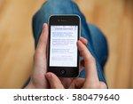 kyiv   february11  hand holding ... | Shutterstock . vector #580479640