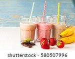long glasses of milkshakes with ... | Shutterstock . vector #580507996