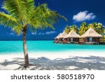 over water bungalows on a... | Shutterstock . vector #580518970