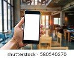a man hand holding smart phone... | Shutterstock . vector #580540270