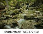 pure mountain stream flowing... | Shutterstock . vector #580577710