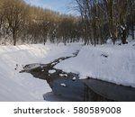 trees covered with snow... | Shutterstock . vector #580589008