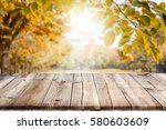 empty wooden table with autumn... | Shutterstock . vector #580603609