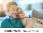 middle aged couple relaxing... | Shutterstock . vector #580614013