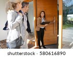 real estate agent inviting... | Shutterstock . vector #580616890