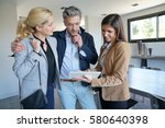 couple visiting home with real... | Shutterstock . vector #580640398