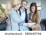 couple visiting home with real... | Shutterstock . vector #580640746