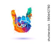 rock. hand sign of the horns.... | Shutterstock .eps vector #580642780