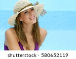 young woman with straw hat in... | Shutterstock . vector #580652119