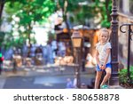 adorable happy little girl... | Shutterstock . vector #580658878