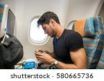 Small photo of Young man feeling disgusted after tasting insipid food in the airplane. Horizontal indoors shot.