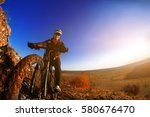 man on mountain bike on the... | Shutterstock . vector #580676470