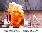 two glass jars with ice tea.... | Shutterstock . vector #580715269