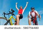 cyclist raising his arms after... | Shutterstock . vector #580756480