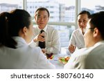 executives meeting over lunch | Shutterstock . vector #580760140