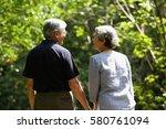 mature couple  holding hands ... | Shutterstock . vector #580761094