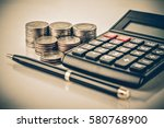 row of coins pen and calculator ... | Shutterstock . vector #580768900