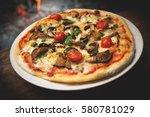 mushroom pizza  italian pizzeria | Shutterstock . vector #580781029