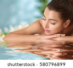 young woman relaxing in spa... | Shutterstock . vector #580796899