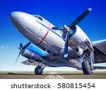 historic airplane on a runway | Shutterstock . vector #580815454