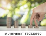 pile coin with hand save money...   Shutterstock . vector #580820980