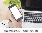 business hand holding smart...   Shutterstock . vector #580822048