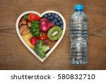 healthy food in heart shaped... | Shutterstock . vector #580832710
