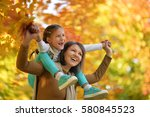 young mother and daughter  | Shutterstock . vector #580845523