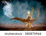 aladdin magic lamp on wooden... | Shutterstock . vector #580870966
