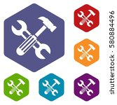 hammer and screw wrench icons... | Shutterstock . vector #580884496
