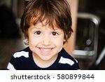 portrait of happy child toddler ... | Shutterstock . vector #580899844
