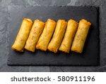 fried spring rolls on black... | Shutterstock . vector #580911196