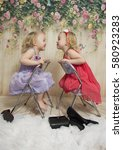 Two Twin Sisters Playing In Th...
