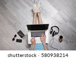 young woman sitting on floor... | Shutterstock . vector #580938214
