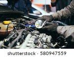 auto mechanic repairing car.... | Shutterstock . vector #580947559