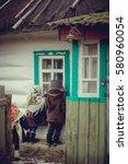 village children in coats and... | Shutterstock . vector #580960054